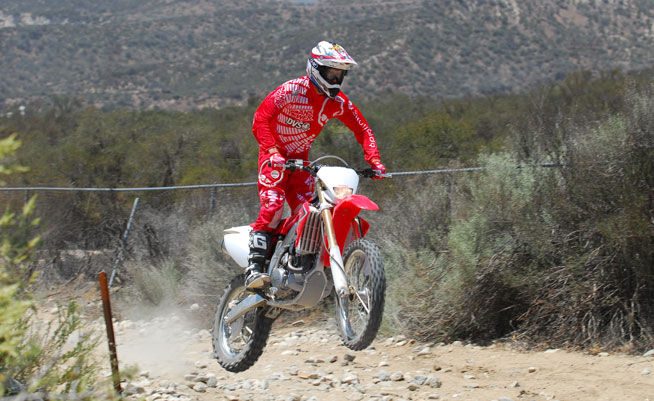 Honda's CRF450X embodies the spirit of Open-class off-road performance with a tractable engine, stable chassis and plush, controlled suspension.