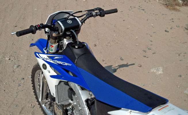 The WR's YZ250F-bred chassis fosters a slim, flat ergonomic layout, and its seat is likewise narrow but well padded.
