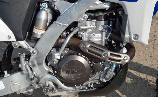 The WR's 449cc engine retains the same basic  five-valve head configuration that it has always had (sorry, no reverse cyllinder head here), but a recent switch to fuel-injection has improved its power and throttle response.