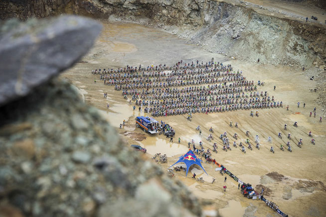 The 500-rider Red Bull Hare Scramble field gets underway on the quarry floor.