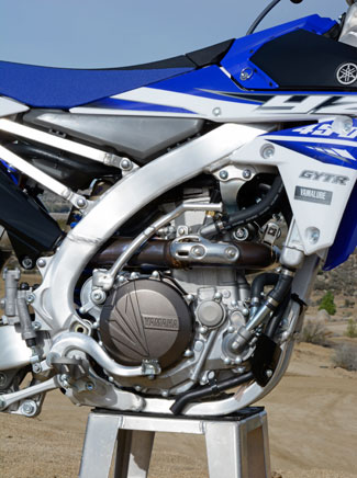 The YZ450F's fuel-injected DOHC Single was already a beast. Yamaha fine-tuned the ECU and ignition curves to make it more controllable without sacrificing its exhilarating power character. Mission accomplished.
