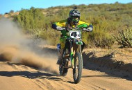 """THR Motorsports Kawasaki-mounted Robby Bell (shown) teamed with Ricky Brabec, Max Eddy Jr. and Steve Hengeveld to win the 2014 Tecate SCORE Baja 1000.  had to deal with several problems but kept on rolling, which ultimately paid off when """"Henge"""" swooped by for the lead and win just before dawn the next day. It was Kawasaki's first Baja 1000 win since 1996. STORY AND PHOTOS BY MARK KARIYA."""