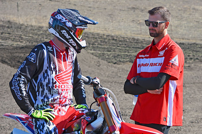 Team Honda mechanic Rich Simmons (right) confers with new Team Honda rider Cole Seely (lefT). The pair have worked together for over five years.