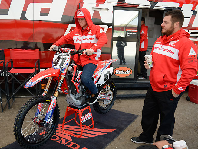 Team Honda factory mechanic Brent Presnell (right) stands by as his rider, Trey Canard, checks the handlebar and lever position on his factory Honda CRF450R. Presnell has been working with Canard since Canard was 13 years old. PHOTOS BY SCOTT ROUSSEAU