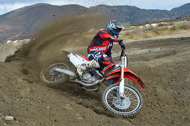 The 2016 CRF450R exhibits a more planted, less nervous feel in the corners thanks to its revised shock linkage and 5mm longer fork legs.