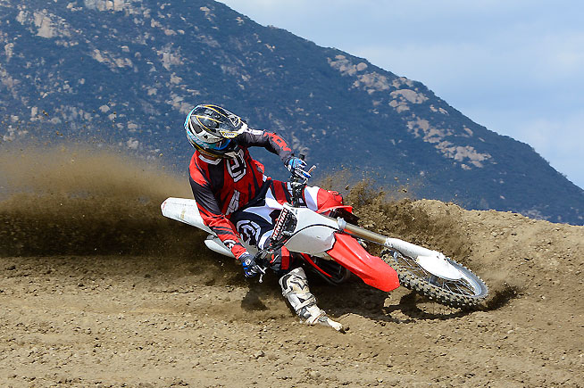 While the CRF450R can rail corners like a demon, we noticed that its angular radiator shrouds still tend to snag knee guards and boots. Honda needs to change the shape of the shrouds.