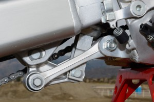 Longer pull rods (dog bones) and a revised delta link give the CRF's Pro-Link linkage ratio a more linear curve that helps plant the bike better during hard acceleration.