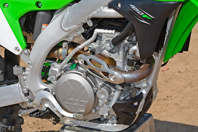 The KX's 449cc, fuel-injected, DOHC engine features lighter, more compact cases, a new cylinder head and a host of changes to lighten the internal parts, and it is shrink-wrapped in a lighter frame with 6mm narrower spars and a new forged downtube. The redesigned header features a new resonator to reduce engine noise emissions.