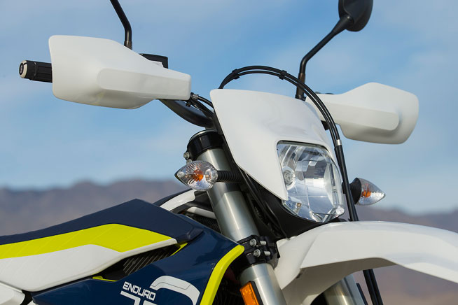We dig that Husqvarna supplied the handguards from the factory, but we wish that the front numberplate deflected just a little air away from the rider in cold, windy weather.