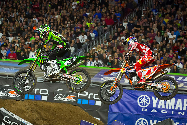 Ryan Dungey (1) got a poor start in the Phoenix Supercross main, but he passed his way into runner-up finish, overtaking Eli Tomac (3) late in the race. Tomac finished third.  PHOTO BY RICH SHEPHERD.