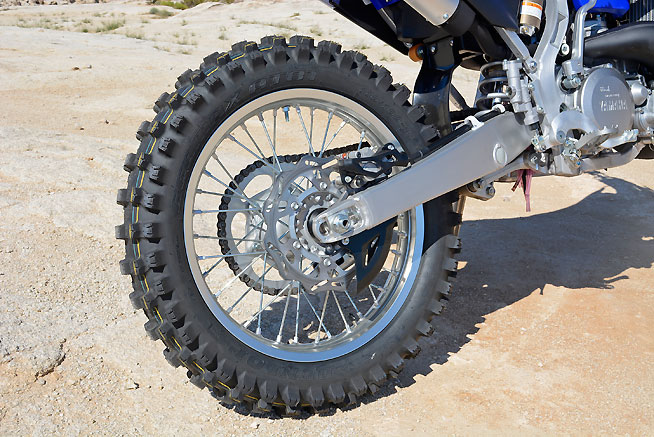 An 18-inch rear wheel and Dunlop AT81 off-road tires, front and rear, are standard equipment on the YZ250X (Yay!). A skid plate and hand guards are not (Boo!).