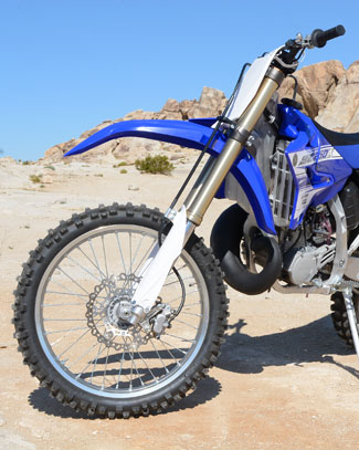 Yamaha revised the YZ250X's KYB fork and shock valving for better off-road compliance, and it works well in a variety of terrain. The fork delivers 11.8 inches of front wheel travel and the rear suspension delivers 12.4 inches. The feel is plush at both ends.