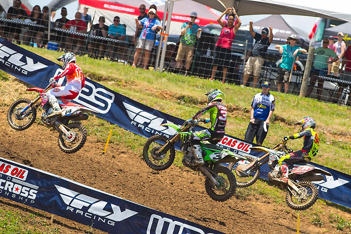 Cole Seely (14), Roczen (94) and Eli Tomac (3) battled in the first moto before Roczen took the lead and went on to win. Tomac finished second. Seely finished third en route to a fourth-place overall finish for the day. PHOTO BY RICH SHEPHERD.