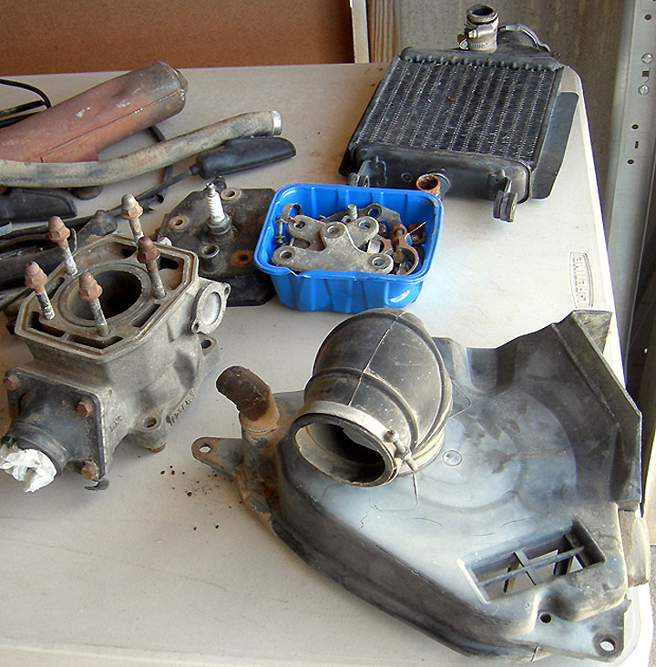 Here are some of the parts that came along with our 1982 Yamaha YZ125's carcass. In our zeal to buy the bike, we only realized afterward that its exhaust pipe was missing. Bummer.
