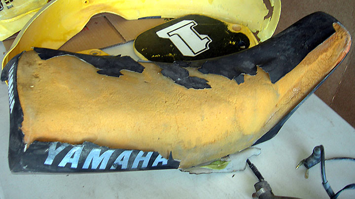 Ripped and RIP: There's no saving this saddle cover.