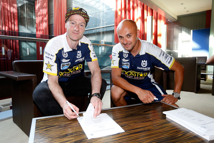 Graham Jarvis (left) is shown here signing a contract extension that will see him remain on the Rockstar Energy Husqvarna Factory Racing off-road team through 2018.