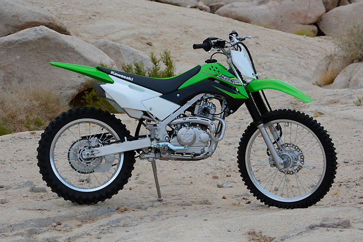 The KLX140G uses the same steel perimeter chassis as the KLX140L, but the G model's larger 21-inch front and 18-inch rear wheels give it a taller seat height and more ground clearance.