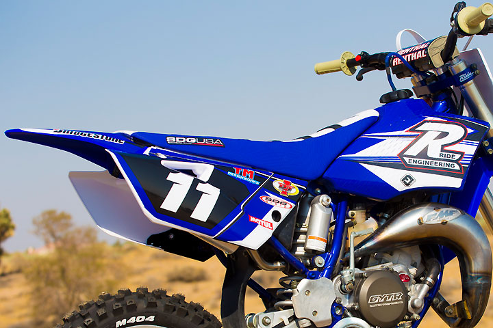 Acerbis plastic, and SDG Gripper seat cover and Flu Designs custom graphics help make the 11-year-old YZ85 look good as new.
