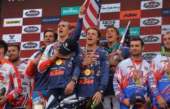 For the first time in ISDE history, the Star Spangled Banner played for the FIM World Trophy team winner, signifying Team USA's long-awaited win in enduro's most prestigious prize. From left, Thad Duvall, Taylor Robert, Kailub Russell and Layne Michael belt it out. PHOTO BY MARK KARIYA.
