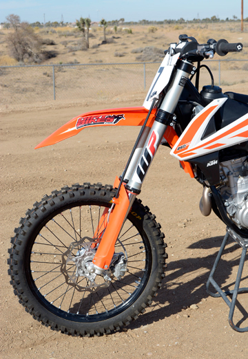 The 250 SX-F's WP AER 48 air fork represents a huge improvement over the coil spring 4CS it replaces.