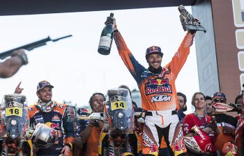 Sam Sunderland hoists the big bottle of bubbly in Buenos Aires, Argentina, to celebrated his first career Dakar Rally win. The Brit DNF'd in his last two Dakar attempts, but it all came good in 2017. PHOTO COURTESY OF RED BULL CONTENT POOL.