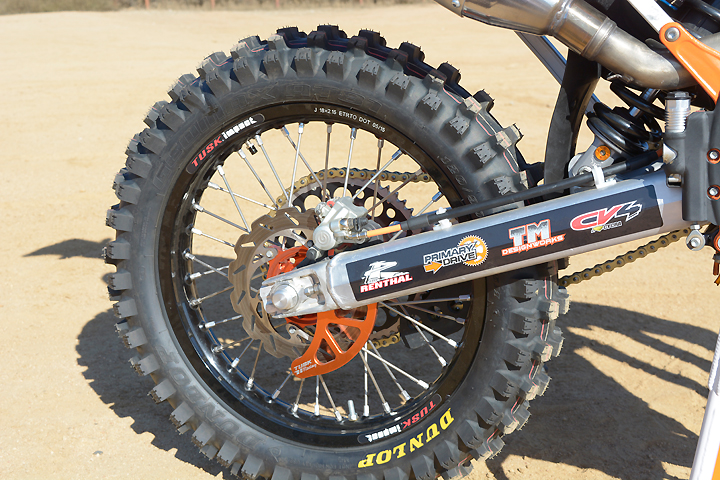 Dunlop AT-81 tires ride on a complete Tusk Off-Road wheel set. The rear disc is protected by a Tusk Off-Road billet disc guard.